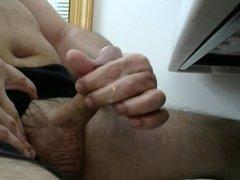 Masturbating and cumming, black shorts