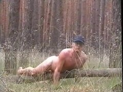 Humping naked a fallen tree trunk
