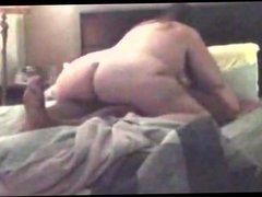 Big butt rides until he cums inside her