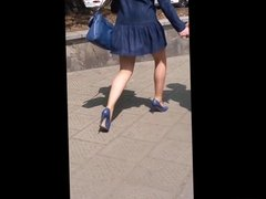 #26 Woman with sexy legs in blue mini dress and heels