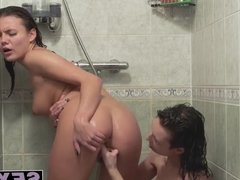 Sexy brunette lesbians licking and fingering in the shower