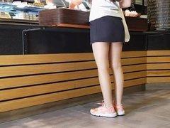 Pantyhose Saleswoman in Shiny Tan Pantyhose