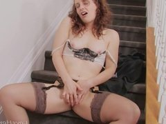 Licking her fingers and plunging her twat
