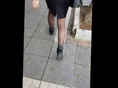 Girl in shiny black pantyhose and tight skirt