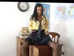 Schoolgirl talking dirty in stockings and garter belt