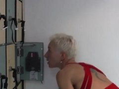 Mature Is Cleaning The Lockers In Red Fishnet Stockings