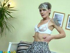Older horny mature granny is fingering masturbating her wet pussy