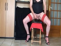 In red and black high heels fishnet stocking dildos and cum