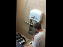 Caught - Guy jerking and cumming with a laptop (Public WC)