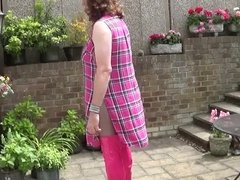 In chastity wearing Hot Pink Thigh Boots
