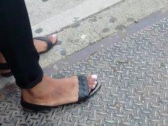 Candid ebony feet at bus stop
