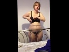 Guy films his wife getting dressed