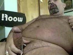 Bear stroking his cock