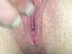 Toying with her gaping pussy