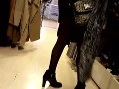 Gf's black pantyhosed legs, high boots, shopping