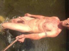 Nudist skinny dipping in river