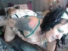 MILF in sexy corset with big boobs riding on dildo