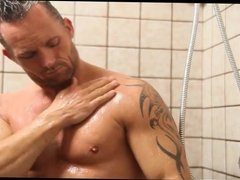 Marcus London washes his butt and his dick in the shower