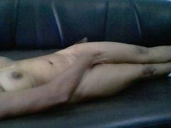 Indian girl masturbating on a sofa