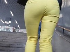 Horny ass of young MILF in yellow pants