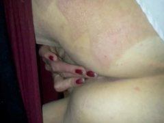 Standing up masturbation as she bends knees