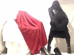Kinky Crossdresser in black lingerie dress and boots play