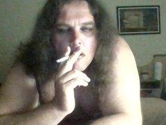 Smoking and rinding on a dildo
