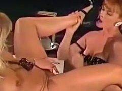 Lesbian sucking on a High Heel