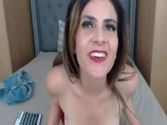 Sexy MILF stretches tight pussy
