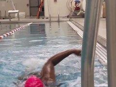 BBW Black woman put a pink latex swimcap