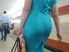 Woman's ass in turquoise dress