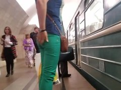 Ass in green pants in the metro