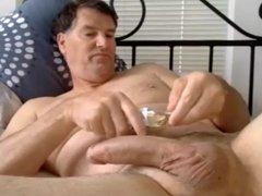 husband strokes mature cock