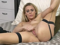 Brittany Bardot playing with her pussy in stockings