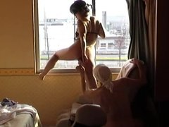 dildoing her by the window