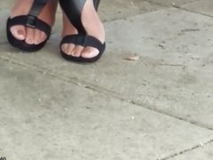 Candid mature lady feet on break
