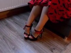 Bare Feet In Black And Red Strappys