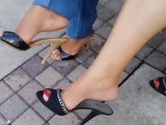Sisters Dangling Mules Outside The Theater