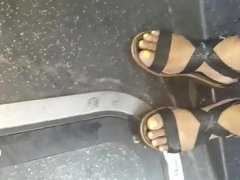 Candid ebony feet yellow toes on the bus