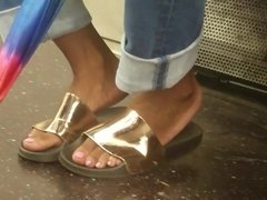 Candid ebony feet in ugly gold shoes