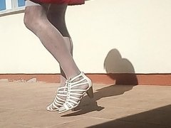 In White nylons and Heels