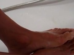 European foot model lathers his beautiful legs and feet