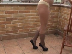 Hot blonde Carla in pantyhose with a butt plug in her ass