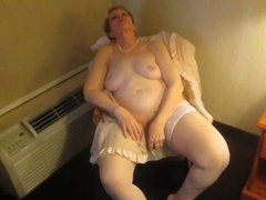 Aunt Sue undresses for intercourse
