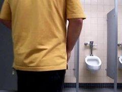 Masturbating in a public bathroom