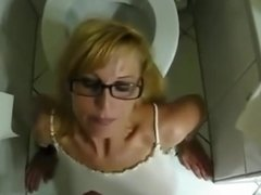 girl with glasses blows and swallows piss from cock