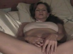 Brunette mom plays with her pussy