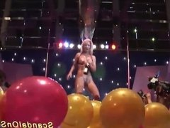 busty oiled Milf on public show stage