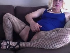 sissy in short blue dress and black stockings