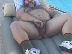 Big Bear jacking off on top of an inflatable air mattress